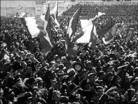 b/w 1930 high angle huge crowd gathered in piazza waving flags cheering for mussolini / italy / newsreel - italy stock videos & royalty-free footage