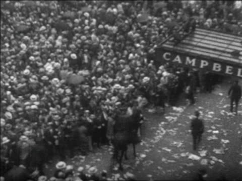 b/w 1926 high angle huge crowd in rain on nyc street at rudolph valentino's funeral / newsreel - 1926 stock videos & royalty-free footage