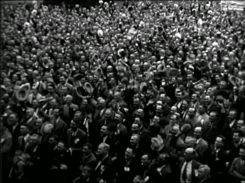 b/w 1962? high angle huge crowd of men cheering + waving their hats - political rally stock videos & royalty-free footage