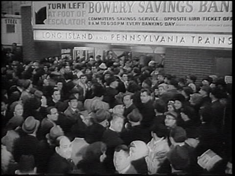 b/w 1966 high angle pan huge crowd waiting in penn station during transit strike / nyc / newsreel - new york city penn station stock videos & royalty-free footage