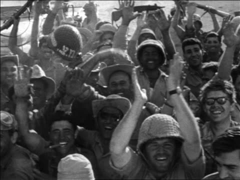 b/w 1967 high angle israeli soldiers cheering at wailing wall after six day war / jerusalem / newsreel - sechstagekrieg stock-videos und b-roll-filmmaterial