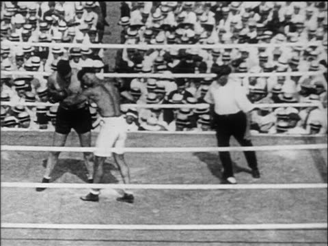 B/W 1919 high angle Jack Dempsey Jess Willard boxing in ring / Willard goes down many times / Toledo Ohio