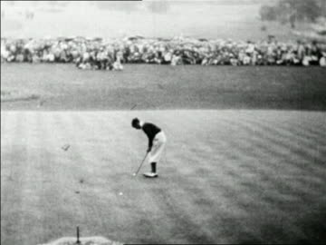 stockvideo's en b-roll-footage met high angle johnny farrell on 18th green putting into hole / mateson, il / u.s. open / newsreel - 1928