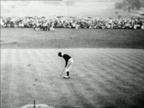 b/w 1928 high angle johnny farrell on 18th green putting into hole / mateson il / us open / newsreel - 1928 stock videos & royalty-free footage