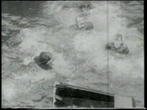 b/w 1915 high angle keystone kops struggling in water near wreckage of rowboat / feature - shipwreck stock videos and b-roll footage