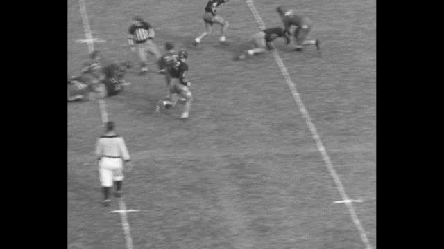 high angle kickoff at grant field in atlanta / various shots, all high angle, of ga tech yellow jackets vs. duke blue devils, including a pass... - インターセプト点の映像素材/bロール