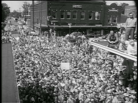 b/w 1952 high angle pan large crowd in small town street / eisenhower whistlestop campaign / newsreel - anno 1952 video stock e b–roll