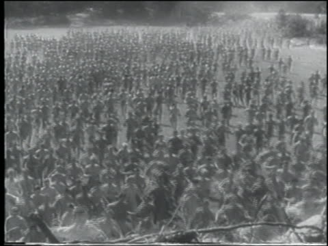 b/w 1943 high angle large crowd of shirtless men run in field + up hill toward camera / us navy cadets - shirtless stock videos & royalty-free footage