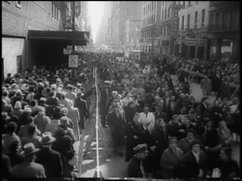 b/w 1958 high angle large crowd of striking garment workers marching on nyc street / newsreel - 1958 stock videos & royalty-free footage