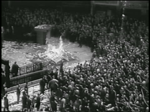 high angle large crowd standing around bonfire in street / coup overthrowing juan peron / argentina - 1955 stock videos & royalty-free footage