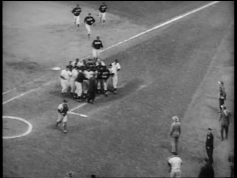 b/w 1953 high angle large group of new york yankees running toward dugout at end of world series / nyc - 1953 stock videos and b-roll footage