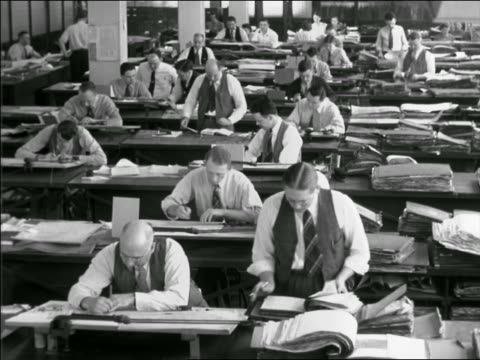 vidéos et rushes de b/w 1941 high angle large office with men working at drafting tables - seulement des hommes