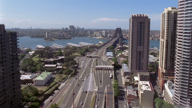 High angle lockdown over Bradfield Highway leading up to Sydney Harbour Bridge with view of Sydney Harbour and North Sydney / Sydney, Australia