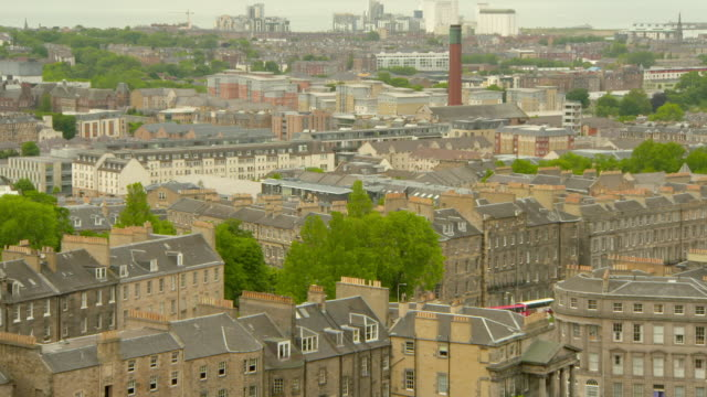 high angle lockdown shot of chimney amidst residential buildings in city - edinburgh, scotland - high up stock videos & royalty-free footage