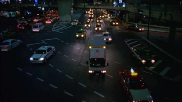 high angle long shot cars traveling under overpass on busy street / tokyo, japan - 2003年点の映像素材/bロール