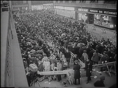 high angle long shot crowd moving thru winding line of police barricades on street / nyc transit strike - 1966 stock videos & royalty-free footage