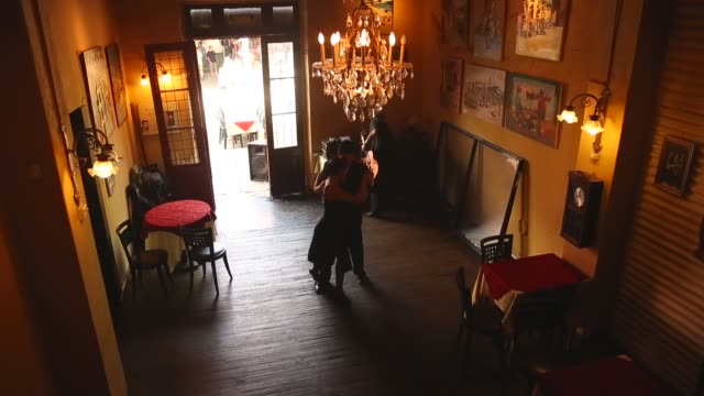 High Angle Long Shot Dancers perform a Tango at La Boca on September 11 2013 in Buenos Aires Argentina