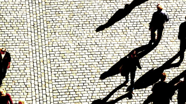high angle long shot fast motion pedestrians walking on brick road / prague, czech republic - kopfsteinpflaster stock-videos und b-roll-filmmaterial