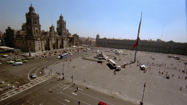 high angle long shot metropolitan cathedral, national palace and flag in zocalo (constitution plaza) / mexico city - zocalo mexico city stock videos & royalty-free footage