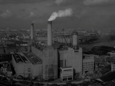 stockvideo's en b-roll-footage met high angle long shot of an operational battersea power station one of the four chimneys is only partly constructed 1958 - wandsworth