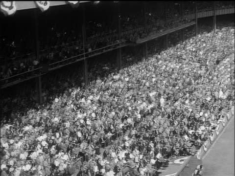 high angle long shot tilt up crowded yankee stadium / world series / yankees vs. dodgers - 1955 stock-videos und b-roll-filmmaterial