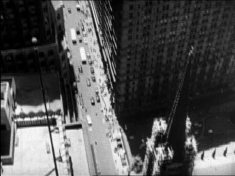 b/w 1945 high angle long shot tilt up new york city street / educational - 1945 stock videos and b-roll footage