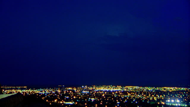 High angle long shot time lapse lightning storm over El Paso at night / Texas