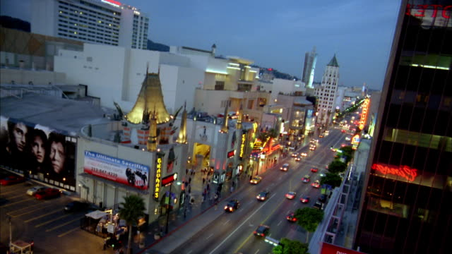 High angle long shot traffic on Hollywood Boulevard at night w/Grauman's Chinese Theater in foreground
