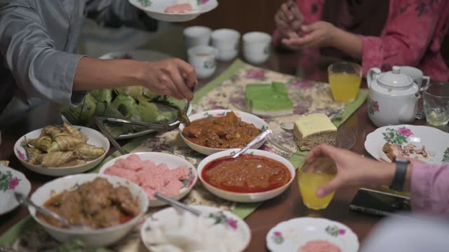 high angle malaysian malay family having family reunion dinner assorted malay food at home celebrating hari raya - event stock videos & royalty-free footage