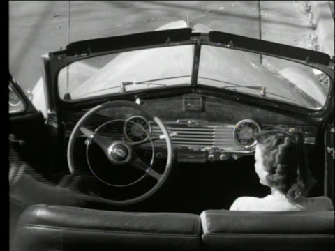 vídeos de stock e filmes b-roll de b/w 1948 high angle man gets in 1947 chevrolet fleetmast convertible with woman / drive away / suburban street - 1947