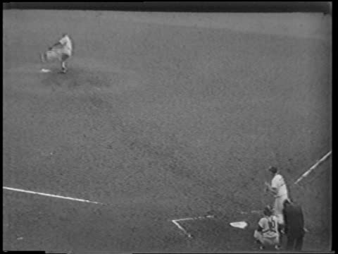 b/w 1951 high angle man pitching ball batter bunting catcher throwing ball to third base as runner slides - 1951 stock videos & royalty-free footage