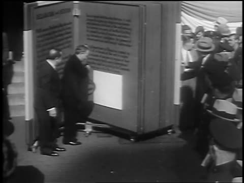 b/w 1933 high angle man signing huge book / petition for world peace / union square nyc / newsreel - 1933 stock videos & royalty-free footage