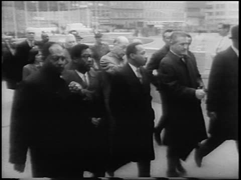 B/W 1967 high angle Martin Luther King Jr leading peace march to United Nations / NYC / newsreel