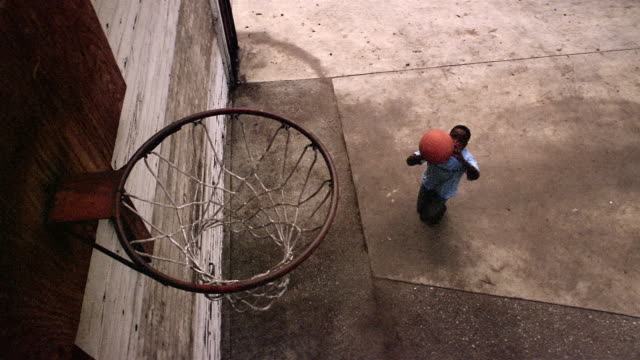 high angle medium shot boy shooting basketball at hoop and missing - shooting baskets stock videos and b-roll footage