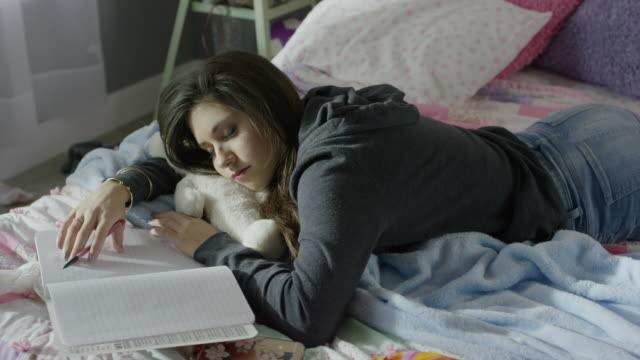 high angle medium shot of girl sleeping on homework / cedar hills, utah, united states - laziness stock videos and b-roll footage