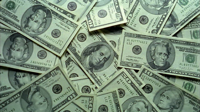 high angle medium shot pile of us currency spinning - twenty us dollar note stock videos & royalty-free footage