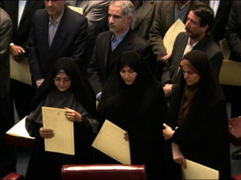 2004 high angle medium shot Reformist women of Iranian parliament preparing to resign in protest / Tehran Iran