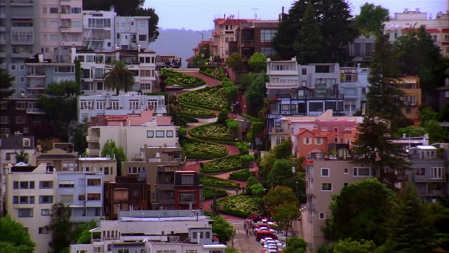 high angle medium shot view of lombard street / san francisco, california - lombard street san francisco stock videos & royalty-free footage