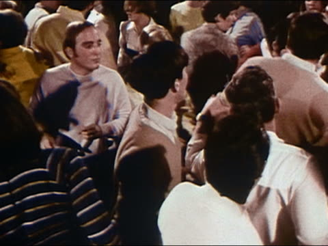 1968 high angle medium shot young men and women dancing - rocking stock videos & royalty-free footage