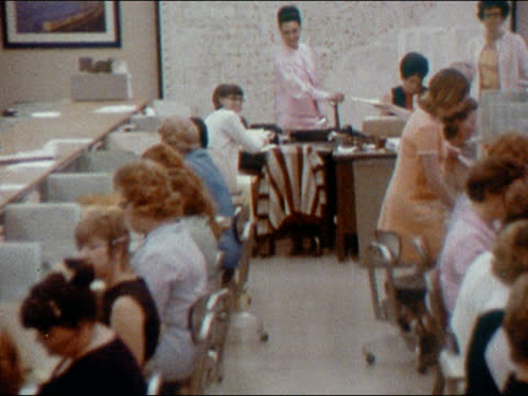 1970 high angle medium shot zoom out office floor of women working in typing pool in classified ads department of newspaper - nur frauen stock-videos und b-roll-filmmaterial