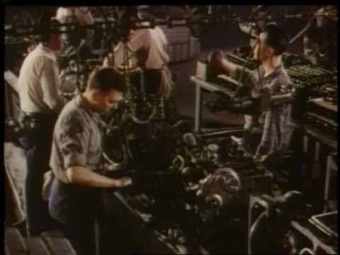 vidéos et rushes de 1951 high angle men assembling car engine on assembly line in chevrolet factory - chaîne de production