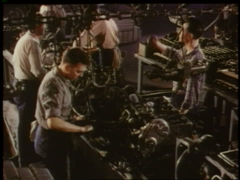 stockvideo's en b-roll-footage met 1951 high angle men assembling car engine on assembly line in chevrolet factory - productielijn werker