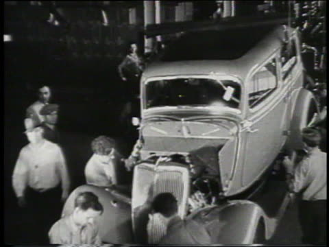 b/w 1932 high angle men assembling car in ford factory - 1932 stock videos and b-roll footage