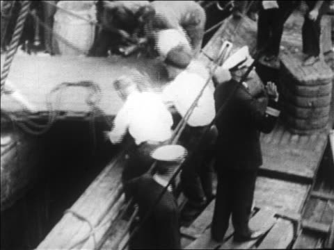 b/w 1926 high angle men unloading gangplank on ship before byrd's expedition to north pole / newsreel - new york harbor stock videos & royalty-free footage