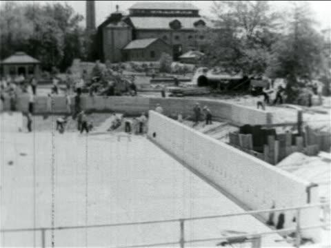 b/w 1934 high angle men working on wpa reservoir construction project / atlantic city nj / documentary - 雇用促進局点の映像素材/bロール