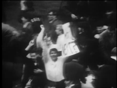 b/w 1969 high angle mets fan in crowd holding what next sign after mets win world series / newsreel - flushing meadows corona park stock videos and b-roll footage