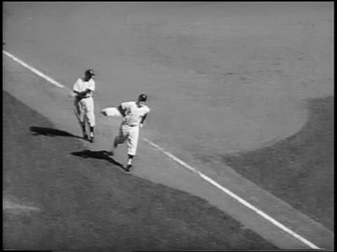 vídeos de stock e filmes b-roll de b/w 1956 high angle pan mickey mantle rounding bases running to home plate shaking hands with players - camisola de basebol