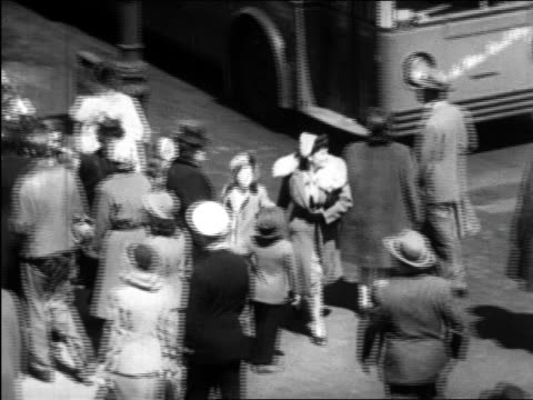 b/w 1945 high angle pan mother + child walking past crowds on new york city street / educational - 1945 stock videos and b-roll footage