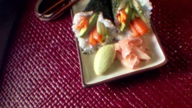 high angle move over a plate of cone sushi with wasabi and ginger. - wasabi sauce stock videos and b-roll footage