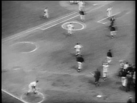 b/w 1953 high angle new york yankees running to mob billy martin at first base / world series / nyc - 1953 stock videos and b-roll footage